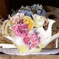 Vacker vas med form av en tekanna